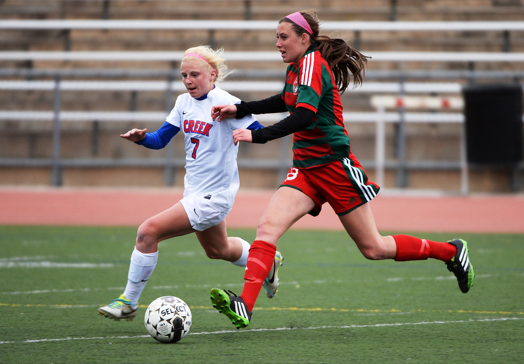 . Meg Halvorson of Cherry Creek High School (7), left, and Brynell Yount of Smoky Hill High School (13) chase after the ball during the first half.   Cherry Creek won 3-0. (Photo by Hyoung Chang/The Denver Post)