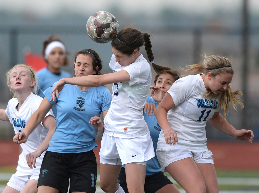 . Valor junior midfielder Jastin Redman (2) got her head on a corner kick in the second half. The Valor Christian High School girl\'s soccer team defeated Pueblo West 4-1 Wednesday night, May 7, 2014 in the first round of the playoffs. (Photo by Karl Gehring/The Denver Post)