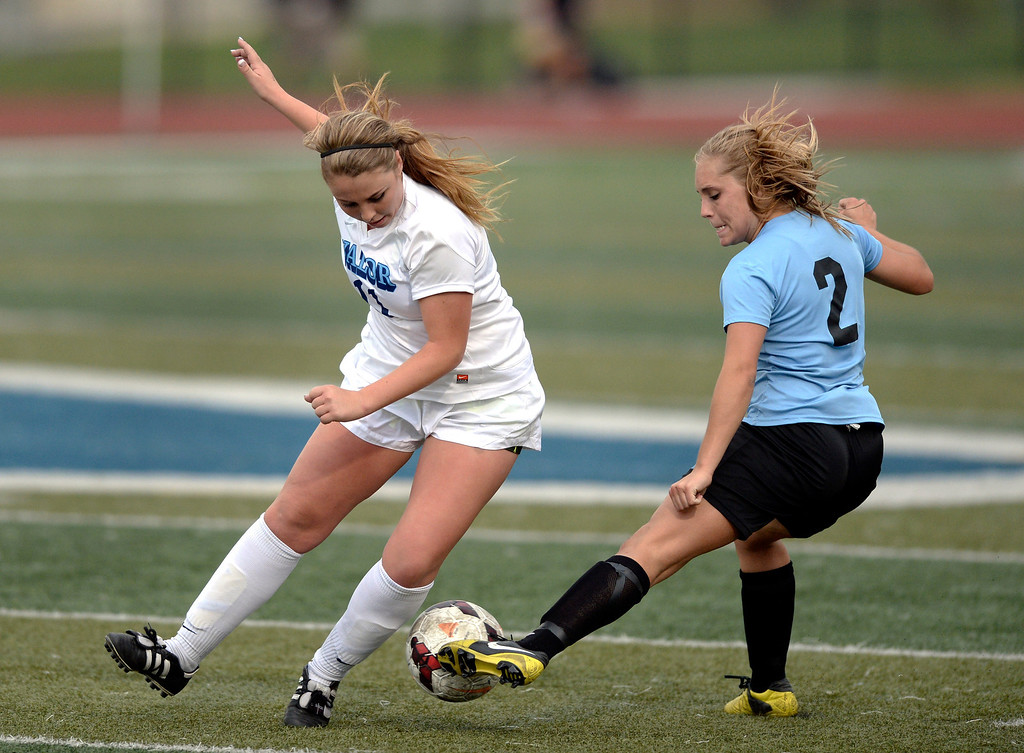 . Valor senior defender Allie Miller (11) competed for the ball with Pueblo West forward Bailee Jameson (2) in the second half. The Valor Christian High School girl\'s soccer team defeated Pueblo West 4-1Wednesday night, May 7, 2014 in the first round of the playoffs. (Photo by Karl Gehring/The Denver Post)