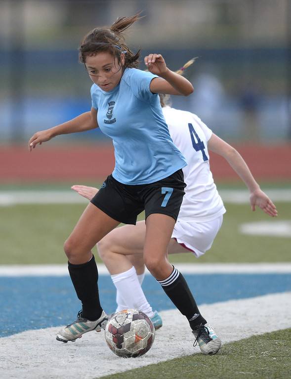 . Pueblo West midfielder Deanna Rangel (7) worked the ball away from Eagles\' junior midfielder Maddison Thompson (4) in the second half. The Valor Christian High School girl\'s soccer team defeated Pueblo West 4-1 Wednesday night, May 7, 2014 in the first round of the playoffs. (Photo by Karl Gehring/The Denver Post)