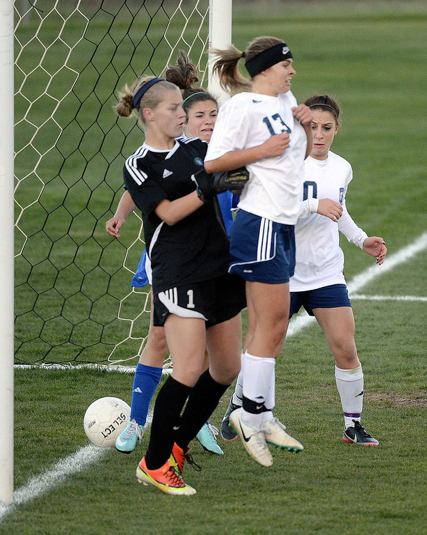 . Columbine forward Amanda Porter screened Doherty goalie Riley Furbush as Kelcey Cavarra kicked through traffic and found the back of the net for the game winner.  (Photo by Karl Gehring/The Denver Post)