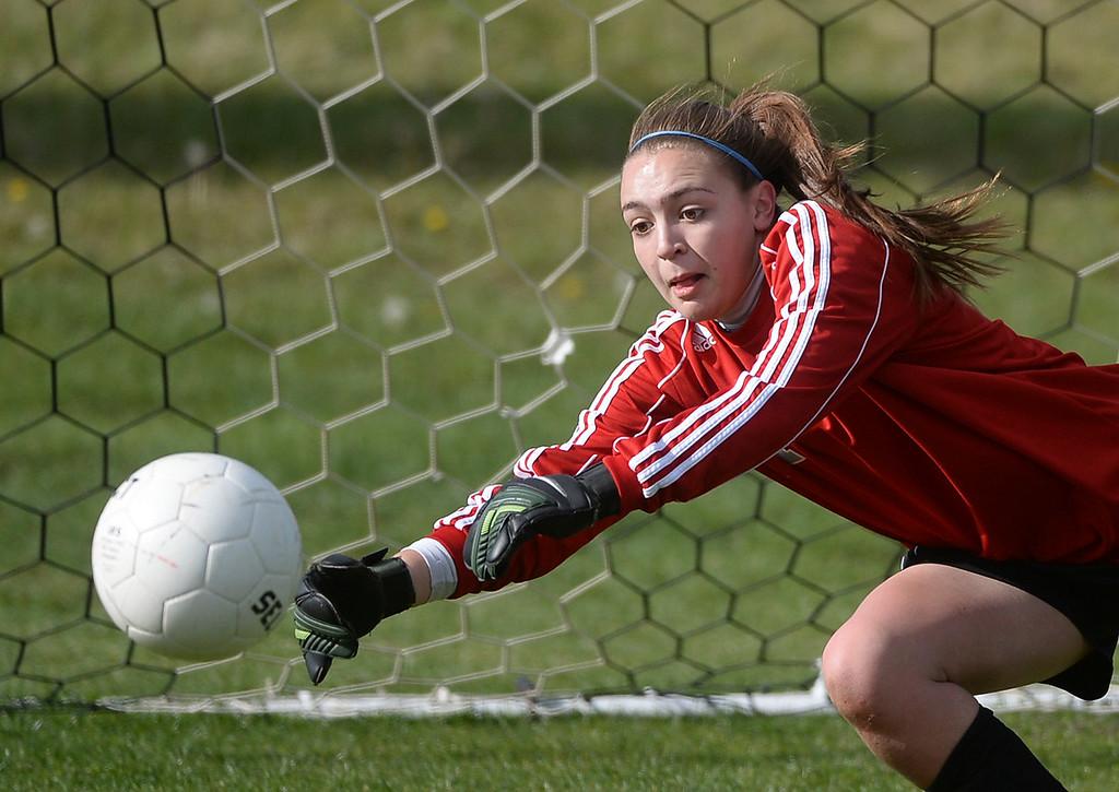 . Rebels goalkeeper Sarah Luebking warmed up before the game.  (Photo by Karl Gehring/The Denver Post)