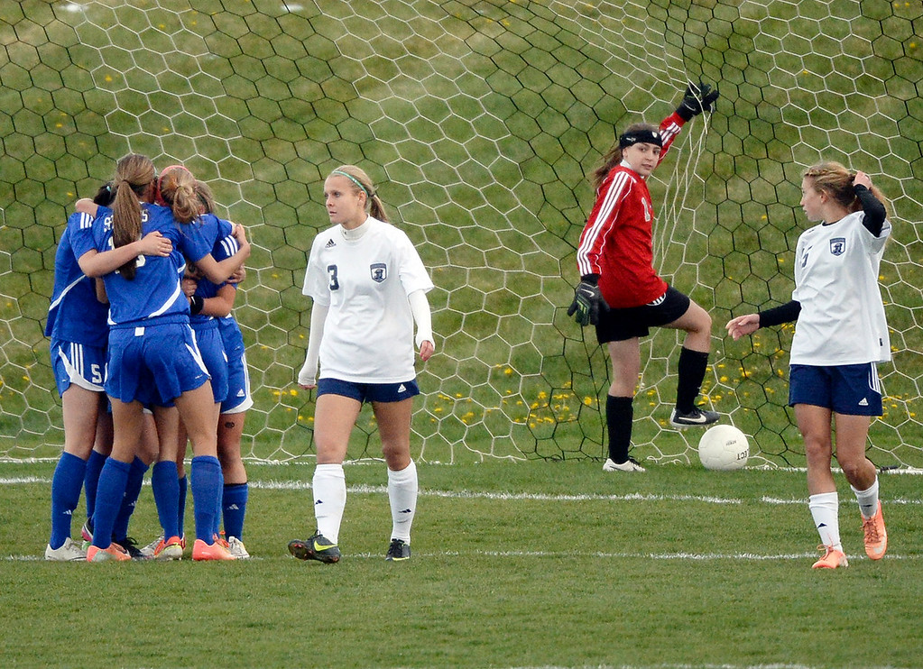 . Doherty players celebrated after junior midfielder Janine Lahey headed in a shot to tie the game in the second half.  (Photo by Karl Gehring/The Denver Post)