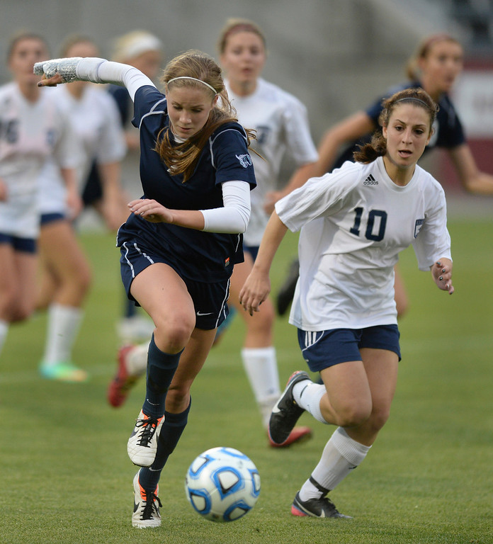 . Ralston Valley forward Alaina Snedden (7) cleared the ball away from Columbine senior Andonia Apergis (10) in the second half. The Columbine High School girl\'s soccer team defeated Ralston Valley 3-1 in the 5A championship game Thursday night, May 22, 2014.  (Photo by Karl Gehring/The Denver Post)