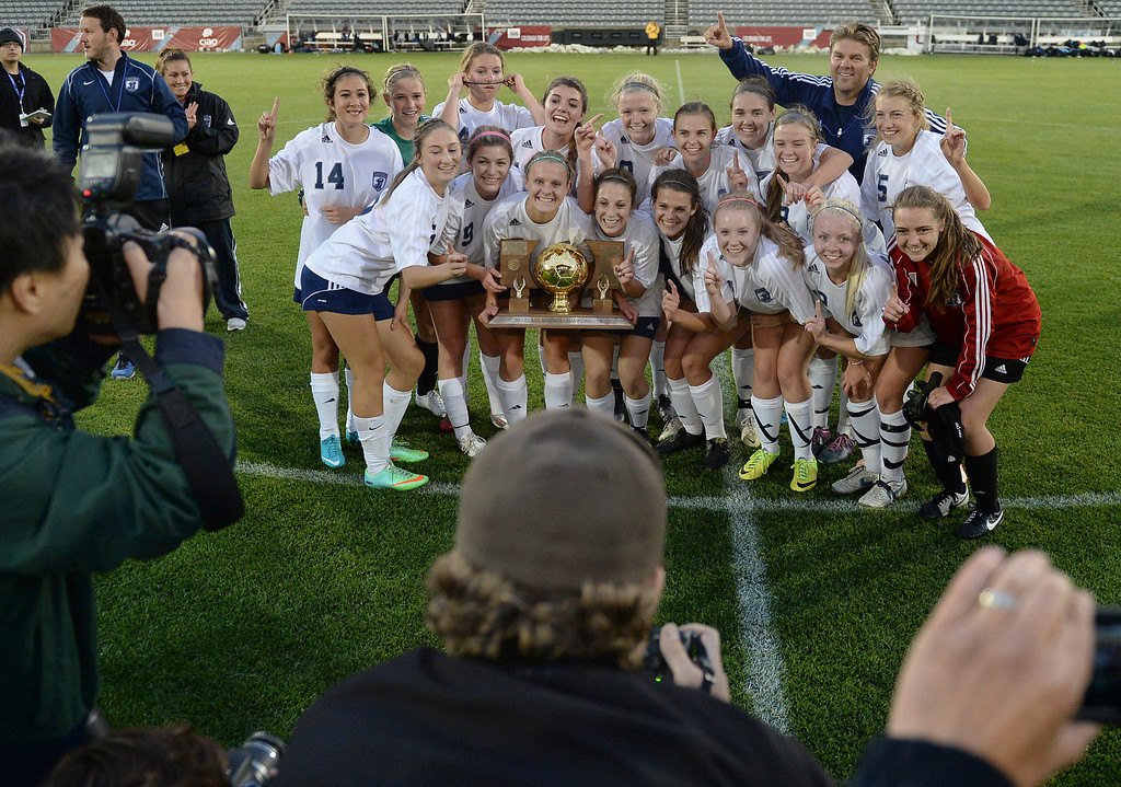 . The Rebels posed with the trophy after the win. The Columbine High School girl\'s soccer team defeated Ralston Valley 3-1 in the 5A championship game Thursday night, May 22, 2014.  (Photo by Karl Gehring/The Denver Post)