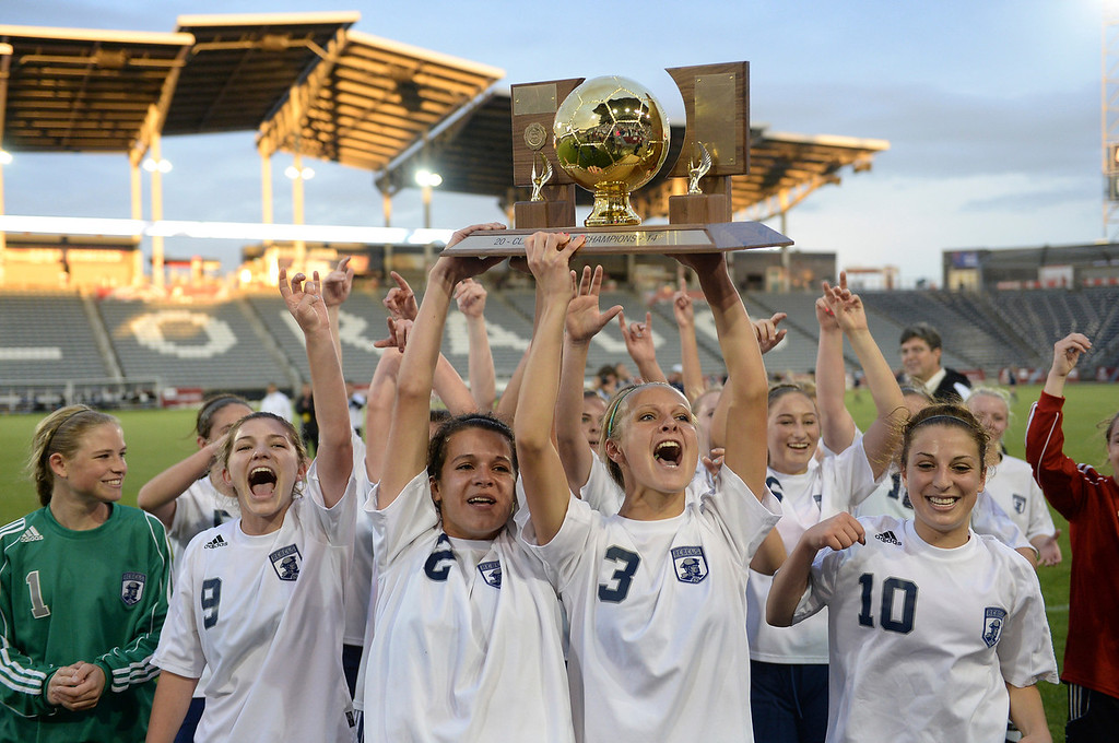 . The Rebels celebrated with the trophy. The Columbine High School girl\'s soccer team defeated Ralston Valley 3-1 in the 5A championship game Thursday night, May 22, 2014.  (Photo by Karl Gehring/The Denver Post)