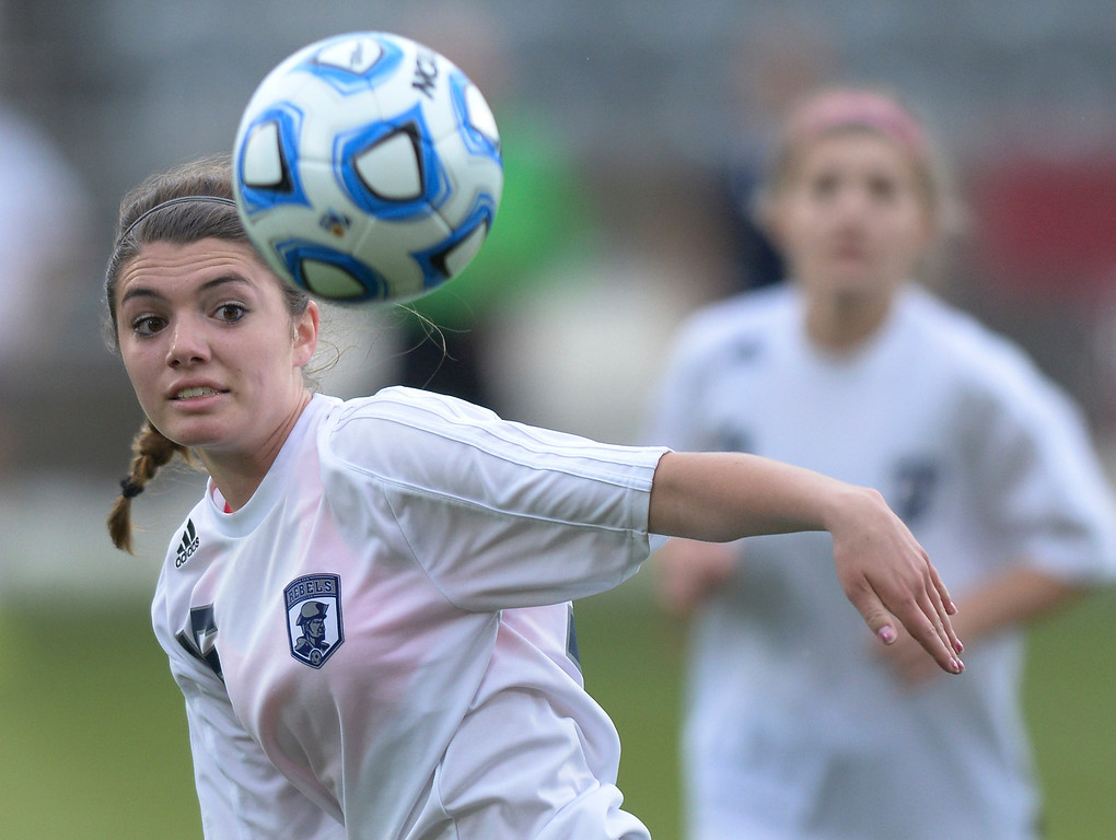 . Columbine sophomore Chloe Chapman chased the ball in the first half. The Columbine High School girl\'s soccer team took on Ralston Valley in the 5A championship game Thursday night, May 22, 2014.  (Photo by Karl Gehring/The Denver Post)