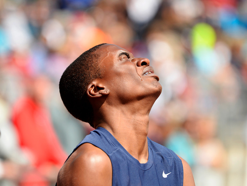 . Jordan Wright, of Cherokee Trail High School, is upset after falling in 5A qualifying 110m hurdles at the Colorado High School State Track and Field Championships, May 15, 2014. Action will continue through Saturday at Jeffco Stadium in Lakewood. (Photo by RJ Sangosti/The Denver Post)