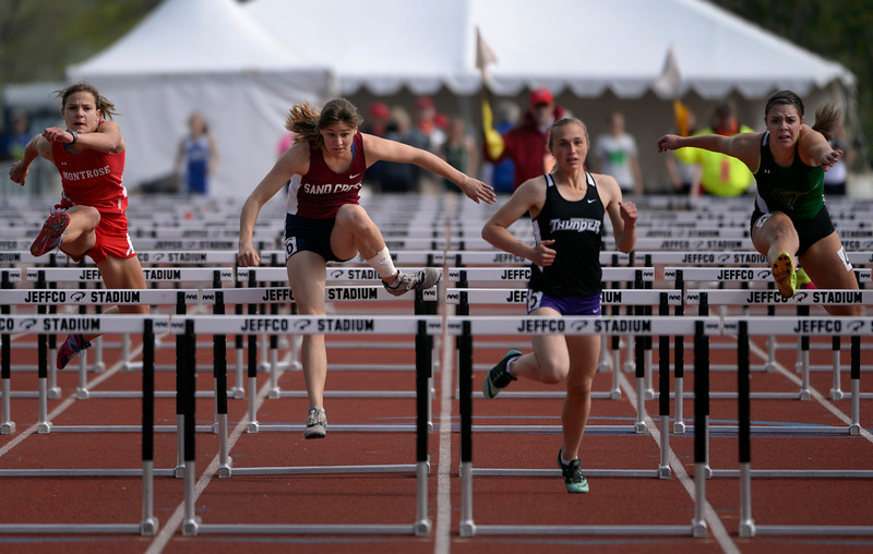 . From left to right competing in the 4A Girls 100 Meter Hurdles are Abi Grace McGee from Montrose, Rebecca Harris from Sandcreek, Ahlyn Nolan from Discovery Canyon, and Hanna Felice from Falcon. The Colorado State High School Track and Field meet takes place at Jeffco Stadium in Lakewood on Saturday, May 17, 2014. (Kathryn Scott Osler, The Denver Post)