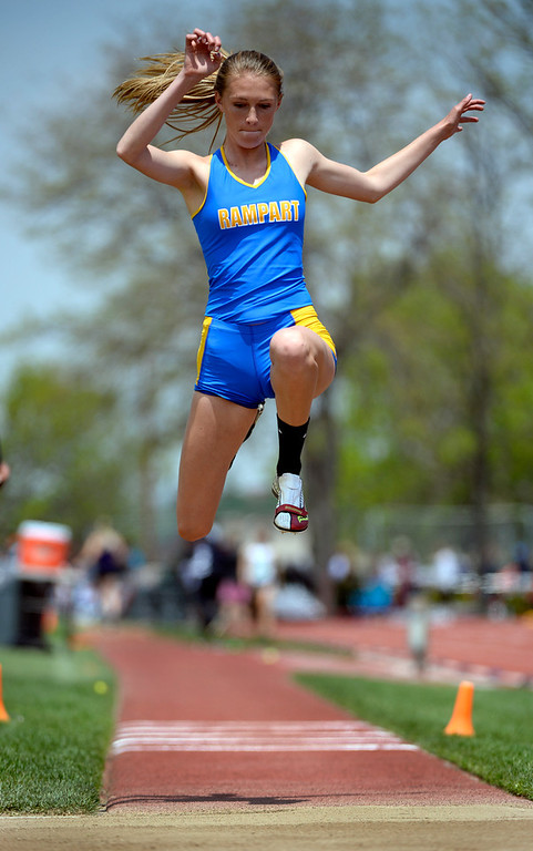 . Ashlyn Hare competes in the Girls Triple Jump event for Rampart High School. The Colorado State High School Track and Field meet takes place at Jeffco Stadium in Lakewood on Saturday, May 17, 2014. (Kathryn Scott Osler, The Denver Post)