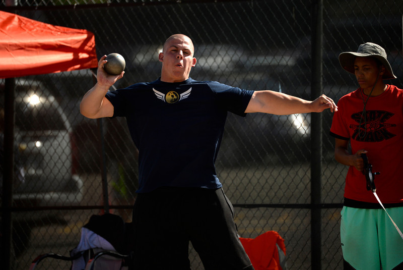 . Austin Williams, a 3A shot putter from Cedaredge High School competes during the Colorado High School State Track and Field Championships, May 16, 2014. Action will continue through Saturday at Jeffco Stadium in Lakewood. (Photo by RJ Sangosti/The Denver Post)
