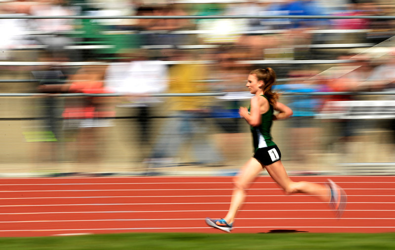 . Niwot\'s Elise Cranny races toward the Class 4A state championship in girls 3,200 meter during the Colorado High School State Track and Field Championships, May 16, 2014. Cranny also broke a state record with her time. (Photo by RJ Sangosti/The Denver Post)
