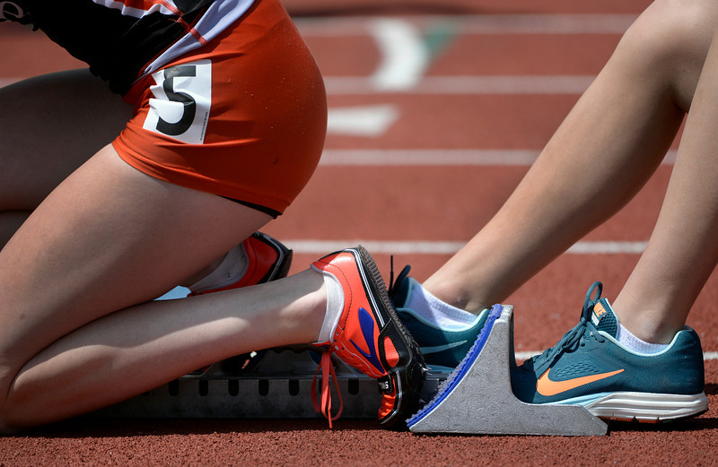 . Nicole Montgomery from Lewis Palmer High School prepares herself in the blocks for the 4A Girls 400 Meter Dash. Montgomery took first place in the event. The Colorado State High School Track and Field meet takes place at Jeffco Stadium in Lakewood on Saturday, May 17, 2014. (Kathryn Scott Osler, The Denver Post)