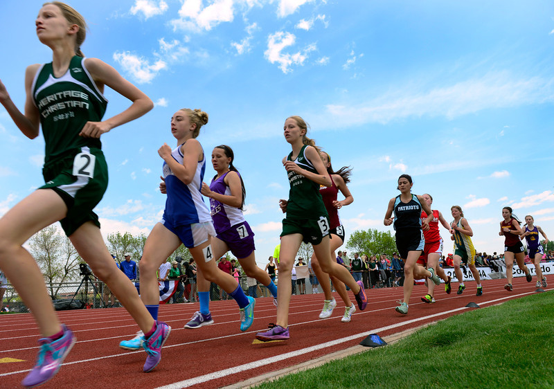 . Competitors in the 1A Girls 1600 Meter Run make their way around one of the curves. The Colorado State High School Track and Field meet takes place at Jeffco Stadium in Lakewood on Saturday, May 17, 2014. (Kathryn Scott Osler, The Denver Post)