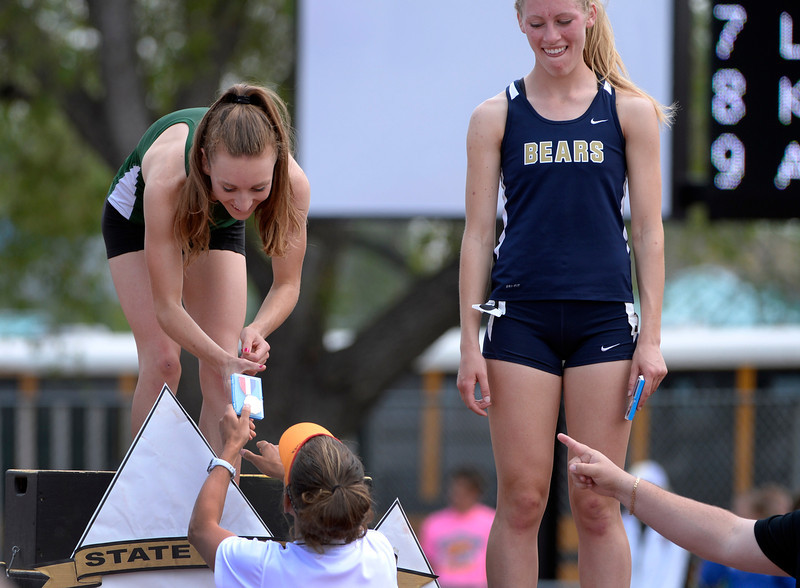 . Record-holder Elise Cranny from Niwot High School receives her medal from former record-holder Melody Fairchild. The Colorado State High School Track and Field meet takes place at Jeffco Stadium in Lakewood on Saturday, May 17, 2014. (Kathryn Scott Osler, The Denver Post)