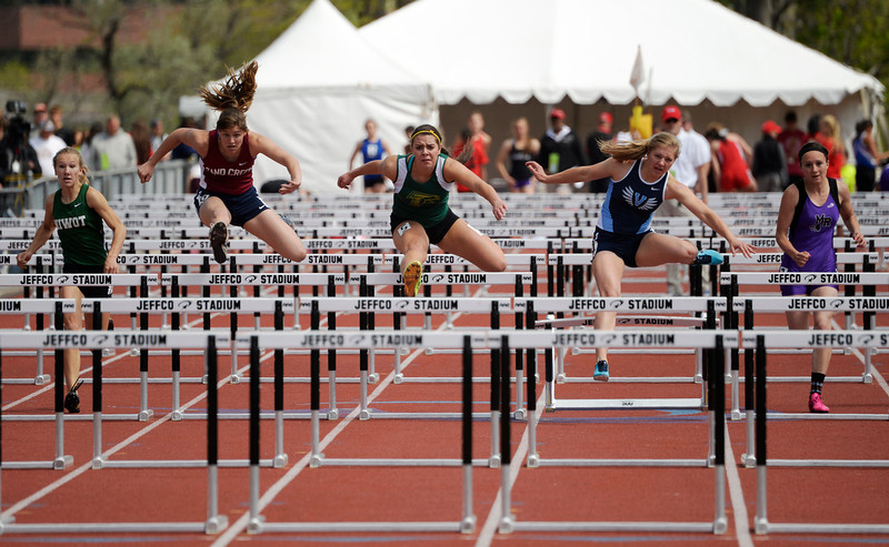 . Runners in the 4A qualifying 100m hurdles race to the finish line during the Colorado High School State Track and Field Championships, May 15, 2014. Action will continue through Saturday at Jeffco Stadium in Lakewood. (Photo by RJ Sangosti/The Denver Post)