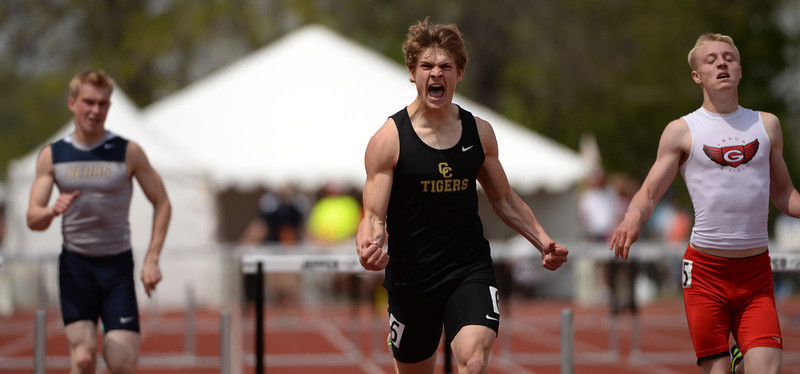. Trenton Stringari of Canon City High School, center, celebrate winning of 4A boys 300m hurdle  during Colorado high school state track and field meet at Jeffco Stadium. Lakewood, Colorado. May 17. 2014. (Photo by Hyoung Chang/The Denver Post)