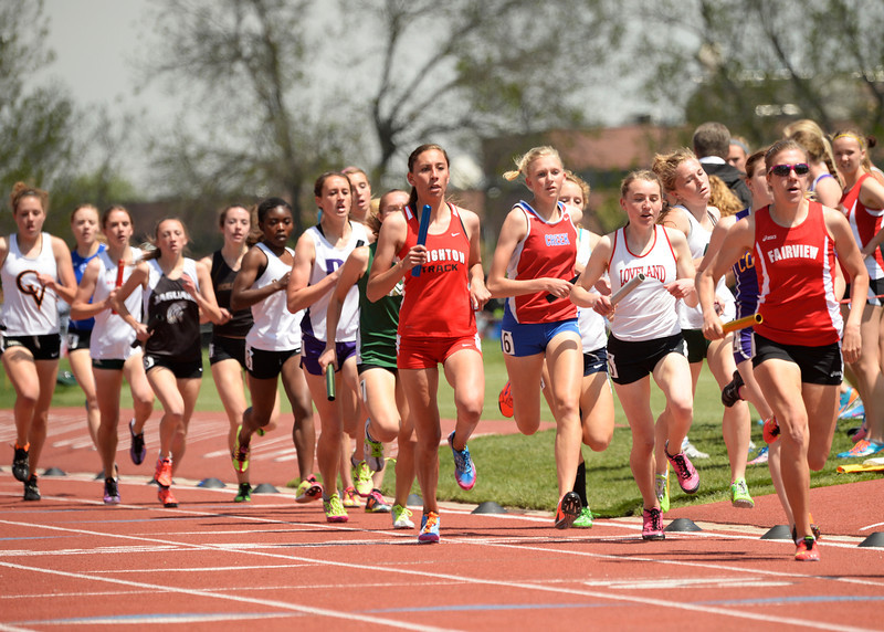 . Runners in the 5A 4x800m relay race to the finish during the Colorado High School State Track and Field Championships, May 15, 2014. Action will continue through Saturday at Jeffco Stadium in Lakewood. (Photo by RJ Sangosti/The Denver Post)