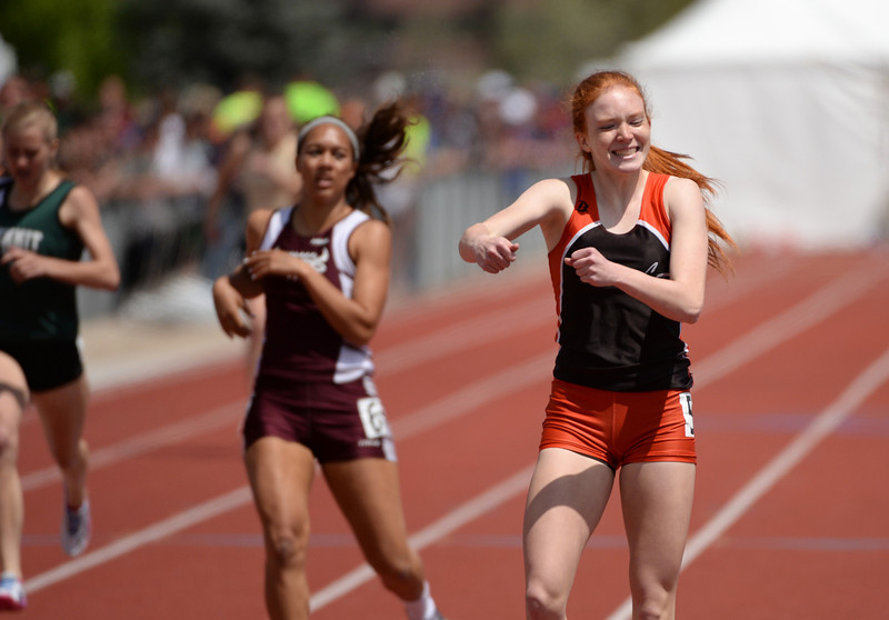 . Nicole Montgomery of Lewis-Palmer High School, right, celebrates her winning of 4A girls 400m dash during Colorado High School state track and field meet at JeffcoStadium. Lakewood, Colorado. May 17. 2014. (Photo by Hyoung Chang/The Denver Post)