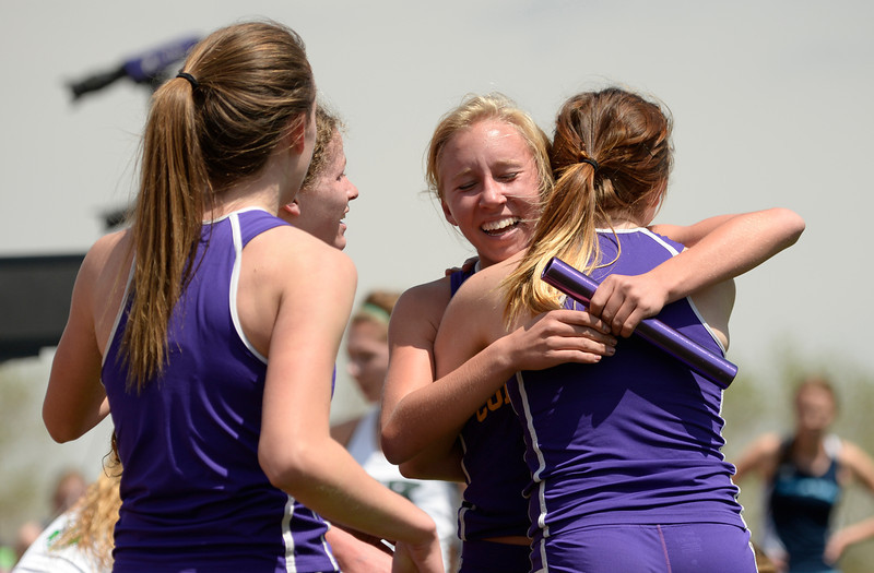 . Fort Collins High School\'s 4x800m relay team celebrate their win during the Colorado High School State Track and Field Championships, May 15, 2014. Action will continue through Saturday at Jeffco Stadium in Lakewood. (Photo by RJ Sangosti/The Denver Post)