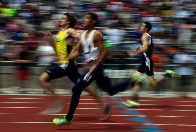 . Competitors sprint toward the finish line in the 3A Boys 400 Meter Dash event. The Colorado State High School Track and Field meet takes place at Jeffco Stadium in Lakewood on Saturday, May 17, 2014. (Kathryn Scott Osler, The Denver Post)
