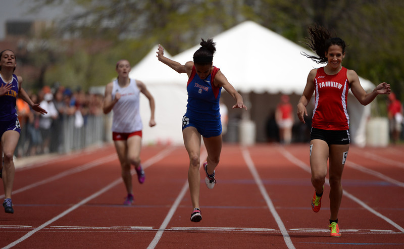 . Heather Harrower of Fairview High School, right, finish 5A girl\'s 400m dash as 1st during Colorado high school state track and field meet at Jeffco Stadium. Lakewood, Colorado. May 17. 2014. (Photo by Hyoung Chang/The Denver Post)