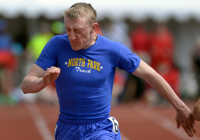 . Clay Russell from North Park High School takes first place in the 1A Boys 100 Meter Dash event. The Colorado State High School Track and Field meet takes place at Jeffco Stadium in Lakewood on Saturday, May 17, 2014. (Kathryn Scott Osler, The Denver Post)