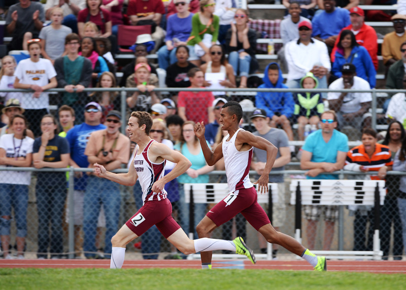 . Chris Baker of Frontier High School, left, pass Conner Wilburn of Classical Academy and won 3A boys 1600m during Colorado high school state track and field meet at Jeffco Stadium. Lakewood, Colorado. May 17. 2014. (Photo by Hyoung Chang/The Denver Post)