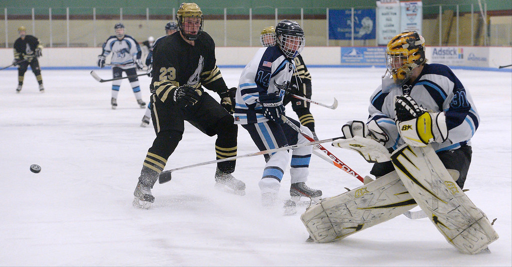 . Ralston Valley goalie Zack LaRocque (31) comes out of goal to knock the puck away during the third period against Monarch January 14, 2014 at Apex Ice Arena. (Photo by John Leyba/The Denver Post)