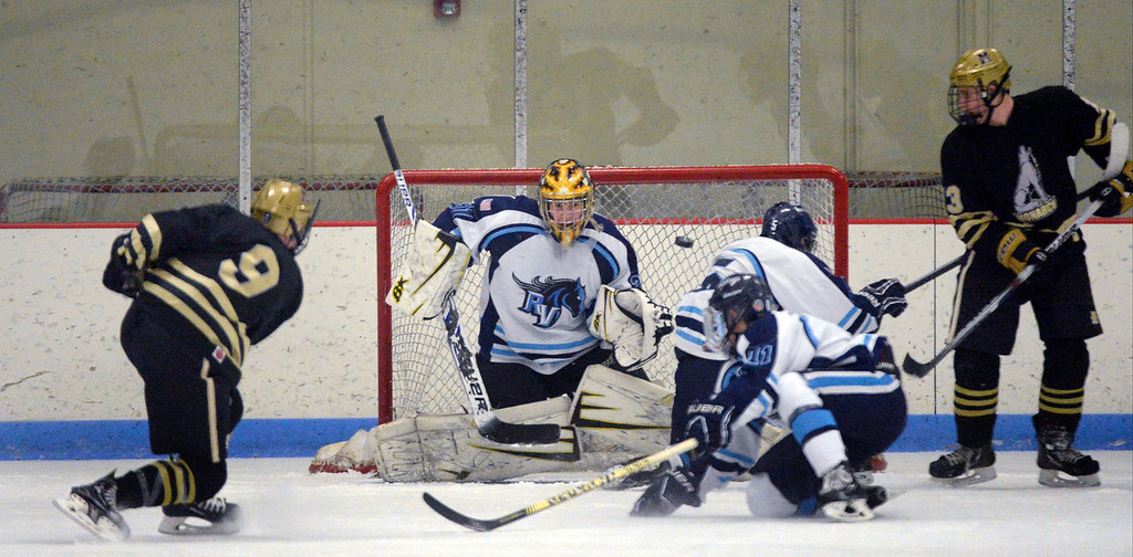 . Monarch Walker Harris (9) takes a shot on Ralston Valley goalie Zack La Rocque (31) during the second period January 14, 2014 at Apex Ice Arena. (Photo by John Leyba/The Denver Post)