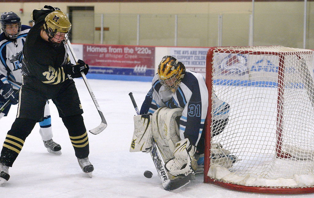 . Ralston Valley goalie Zack LaRocque (31) makes a save on a shot by Monarch Cameron Gardner (23) during the third period January 14, 2014 at Apex Ice Arena. (Photo by John Leyba/The Denver Post)