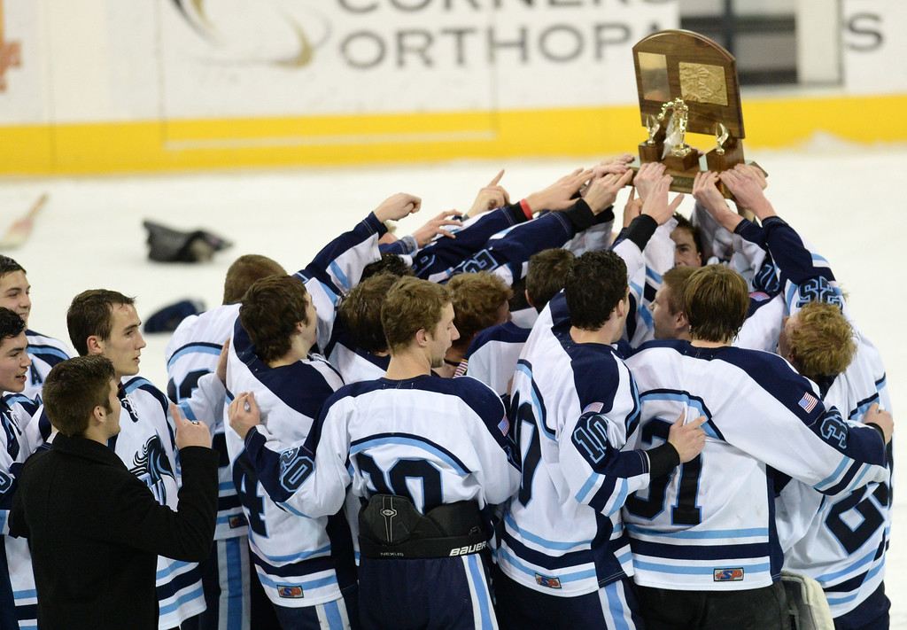 . Ralston Valley High School players celebrate winning Colorado High School State Championship Hockey game against Monarch High School at the Denver Coliseum. Denver, Colorado. March 1, 2014. Ralston Valley won 4-1. (Photo by Hyoung Chang/The Denver Post)