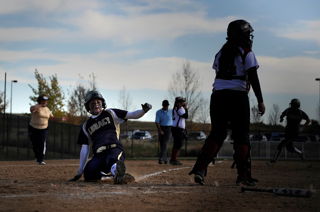 . AURORA CO: Oct. 19, 2013  Maddie Ertle of Legacy High School slides in to home to score for her team as they took on Dakota Ridge during the 5A softball quarterfinals on Oct. 19, 2013.   (Photo By Erin Hull/The Denver Post)