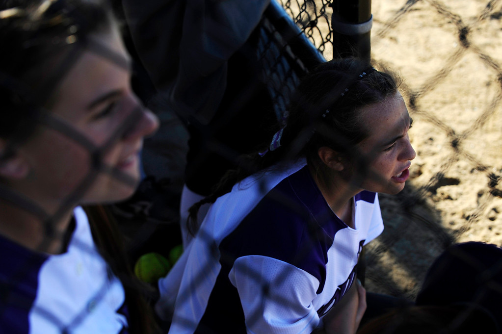 . AURORA CO: Oct. 19, 2013  The Douglas County Softball team cheers from the dugout as they took on Brighton. The 5A softball quarterfinals were held at the Aurora Sports Park on Oct. 19, 2013.   (Photo By Erin Hull/The Denver Post)