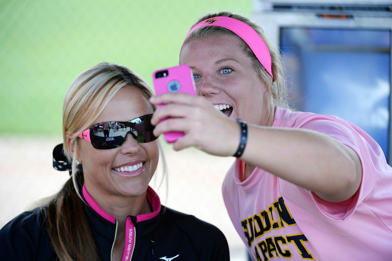 . High school Softball player, Brittany Nollkamper, right, playing for Sudden Impact team from the Houston Texas area, snaps a selfie with her hero, former softball fast pitch player, Jennie Finch at the Colorado Sparkler, Sparkler Junior and Fireworks girls fast pitch club softball tournament at the Aurora Sports Park Wednesday afternoon, July 02, 2014. Finch, a former pitcher, won the 2001 Women\'s College World Series, lead the USA team to a gold medal at the 2004 Olympics and won a silver medal for the USA in the 2008 Olympics. The Colorado Sparkler & Fireworks, Sparkler Juniors, fast pitch softball tournament is one of the largest high school and junior girls fast pitch club tournaments in the country which is being played at several locations on the front range through July 06, 2014 that features over 800 teams from across the country.(Photo By Andy Cross / The Denver Post)
