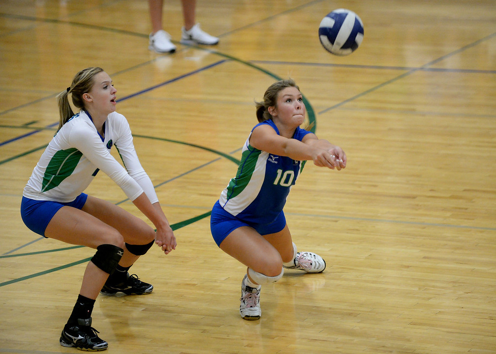 . COLORADO SPRINGS, CO - August 31 : Kaylee Bussinger of Doherty High School (10) receives the ball by Rachel Staudte (2) during the game against Grandview High School at Doherty High School Gym. Colorado Springs, Colorado. August 31, 2013. (Photo by Hyoung Chang/The Denver Post)