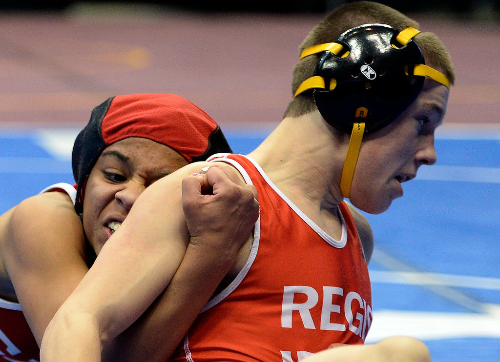 . Maya Nelson of Denver East taking control of her match against Carl Camposanto of Regis during their 5A 106-pound match on the first day of Colorado High School State Wrestling February 20, 2014 Pepsi Center. Maya defeated Camposanto 13-9.  (Photo by John Leyba/The Denver Post)