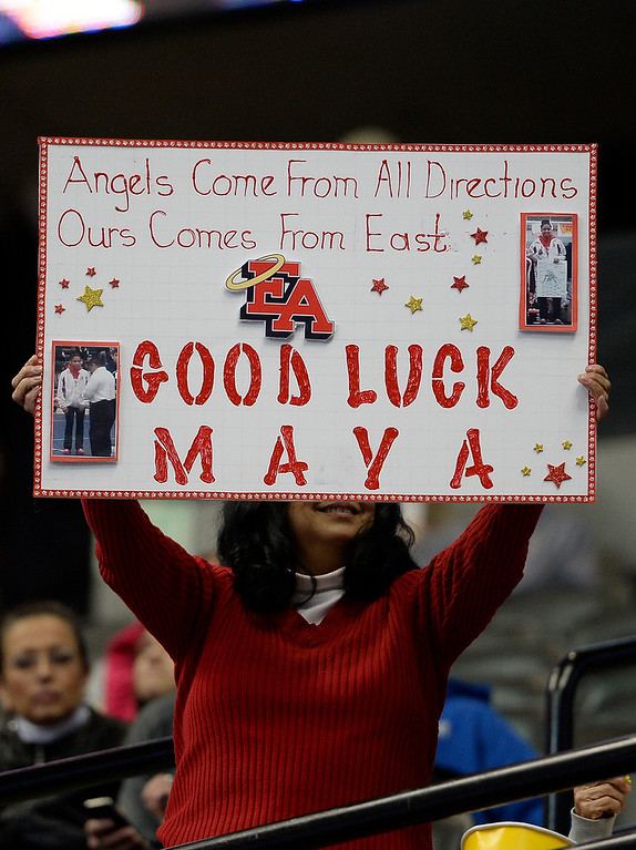 . Fans hold up signs for Maya Nelson of Denver East on the first day of Colorado High School State Wrestling February 20, 2014 Pepsi Center. (Photo by John Leyba/The Denver Post)