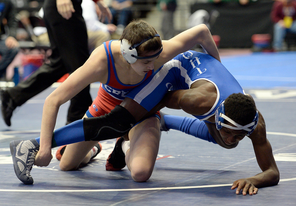 . Matt Finesilver of Cherry Creek takes control of Wendell Berry of Thornton during Class 5A 113 pound action on the first day of Colorado High School State Wrestling February 20, 2014 Pepsi Center. Finesilver defeated Berry (Photo by John Leyba/The Denver Post)