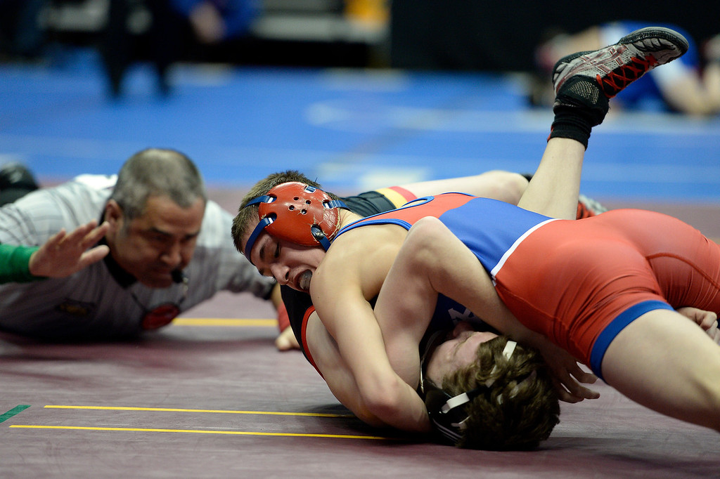 . Josh Finesilver of Cherry Creek pins Gerimie Meier of Castle View during Class 5A 106-pound action on the first day of Colorado High School State Wrestling February 20, 2014 Pepsi Center. (Photo by John Leyba/The Denver Post)