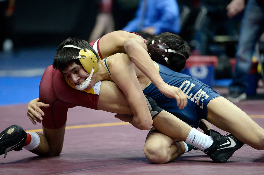 . Emmanuel Barba of Olate (R) tries to gain control over Macky Sandoval of Brush in Class 3A, 126 lbs action on the first day of Colorado High School State Wrestling February 20, 2014 Pepsi Center. Sandoval defeated Barba 10-8. (Photo by John Leyba/The Denver Post)