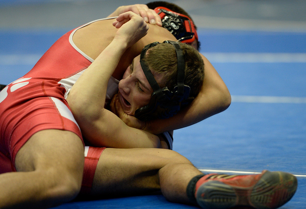 . DENVER, CO - FEBRUARY 20: Lorenzo Pena of Ignacio (L) gets a head lock on Jake Shaffer of Rye during class 2A 138 pound action on the first day of Colorado High School State Wrestling February 20, 2014 Pepsi Center. Pena defeated Shaffer by a pin. (Photo by John Leyba/The Denver Post)