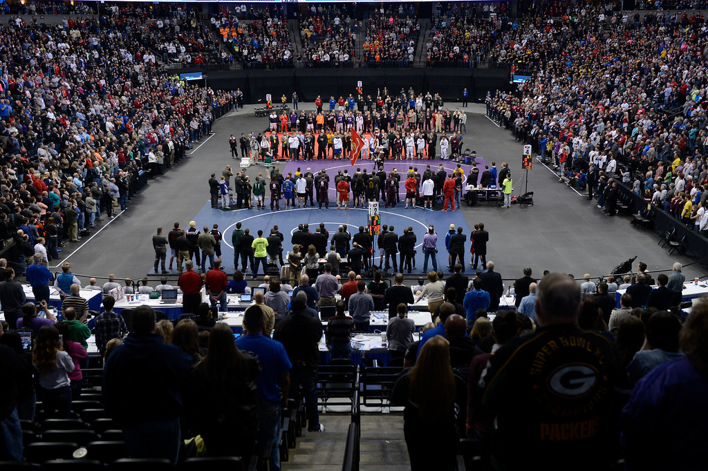. DENVER, CO - FEBRUARY 22: Wrestlers stand for the national anthem before the start of matches. The Colorado Wrestling Tournament was held at the Pepsi Center in Denver, Colo. on February 22, 2014. (Photo by Andy Cross/The Denver Post)