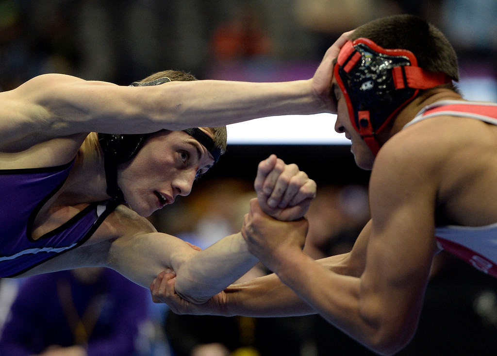 . DENVER, CO - FEBRUARY 20: Jake Shaffer of Rye (L) straight arms Lorenzo Pena of Ignacio during class 2A 138 pound action on the first day of Colorado High School State Wrestling February 20, 2014 Pepsi Center. Sandoval defeated Barba 10-8. (Photo by John Leyba/The Denver Post)
