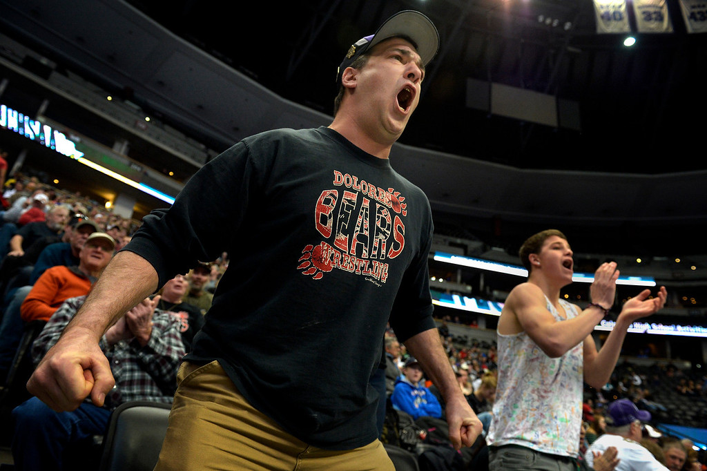 . DENVER, CO. - FEBRUARY 22: Dean Valdez cheers for his son, Deano, a senior at Dolores High School, during the Colorado State Wrestling Championship at the Pepsi Center in Denver, CO February 22, 2014. Deano Valdez won his 2A 145-pound consolation match. (Photo By Craig F. Walker / The Denver Post)