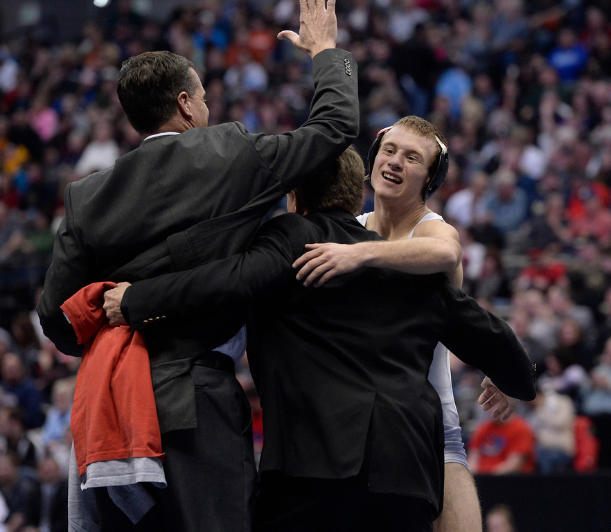 . DENVER, CO - FEBRUARY 22: Jesse Reead of Paonia (in white) celebrates after defeating Austin Coy of Swink in the 2A 126lb. championship match. The Colorado Wrestling Tournament was held at the Pepsi Center in Denver, Colo. on February 22, 2014. (Photo by Andy Cross/The Denver Post)