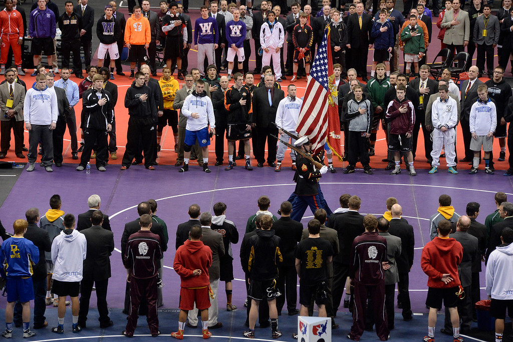. DENVER, CO - FEBRUARY 22: The color guard presents the flag before the start of the tournament. The Colorado Wrestling Tournament was held at the Pepsi Center in Denver, Colo. on February 22, 2014. (Photo by Andy Cross/The Denver Post)