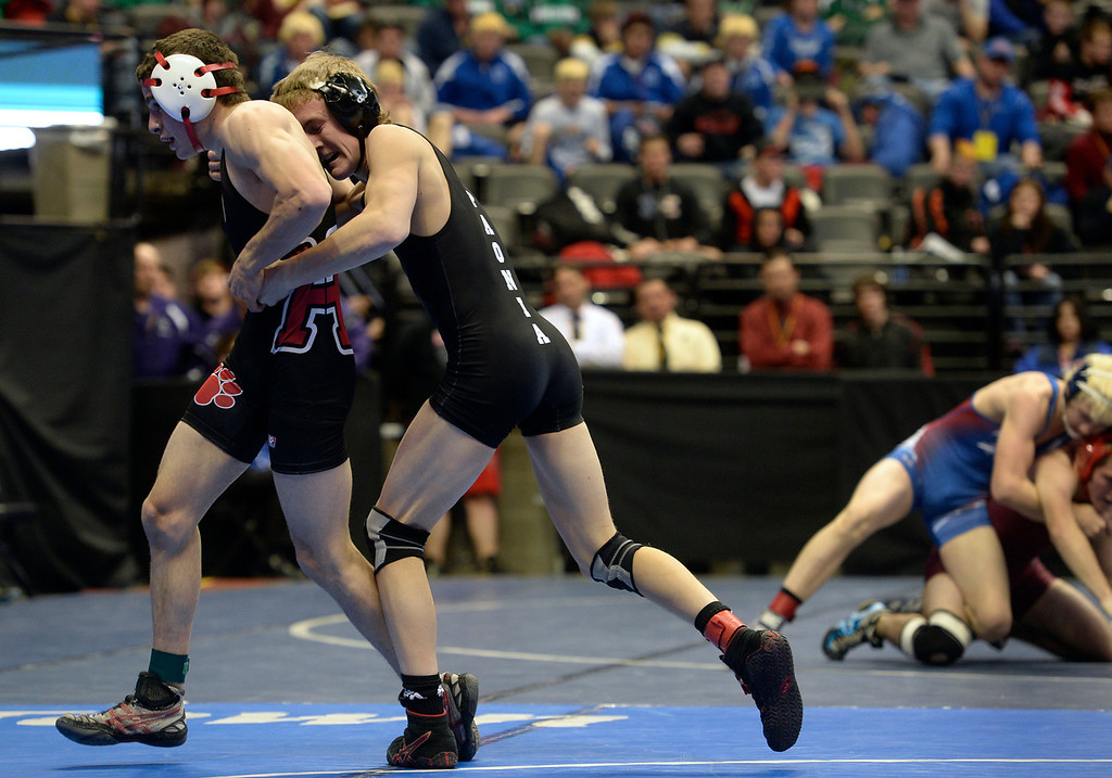. DENVER, CO - FEBRUARY 21: Josh Altman, right, from Paonia wrestles Brendon Crum from Holly in the 2A 120 pound class. The Colorado Wresting State Championships take place at the Pepsi Center with the quarterfinals taking place on Friday, Feb. 21, 2014. (Photo by Kathryn Scott Osler/The Denver Post)
