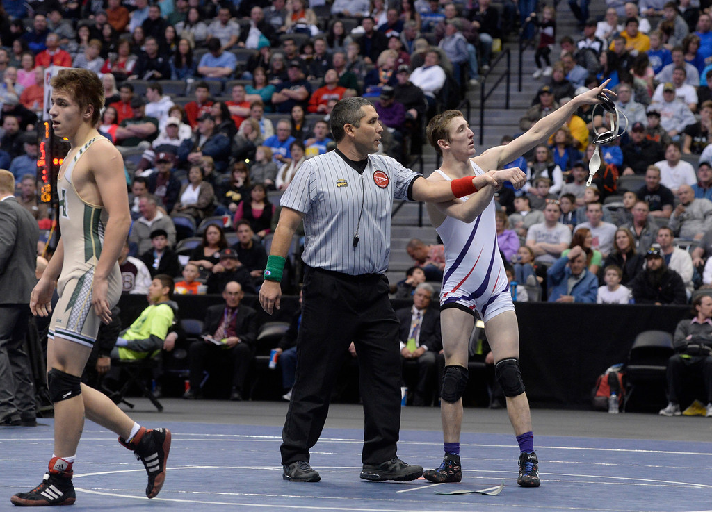 . DENVER, CO - FEBRUARY 22: Stetson Loader of Baca County (in white) defeats Jakeob Trujillo of Highland (in yellow and green) in the 2A 120lb. championship match. The Colorado Wrestling Tournament was held at the Pepsi Center in Denver, Colo. on February 22, 2014. (Photo by Andy Cross/The Denver Post)