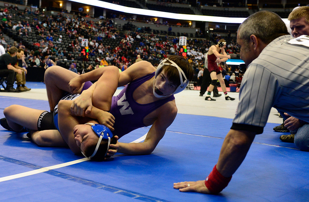 . DENVER, CO - FEBRUARY 21: Jacob Lueth from Wray wrestles Salomon Chavez from Center in the 2A 152 pound class. The Colorado Wresting State Championships take place at the Pepsi Center with the quarterfinals taking place on Friday, Feb. 21, 2014. (Photo by Kathryn Scott Osler/The Denver Post)